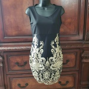 Dresses & Skirts - Sexy Black and Gold Dress